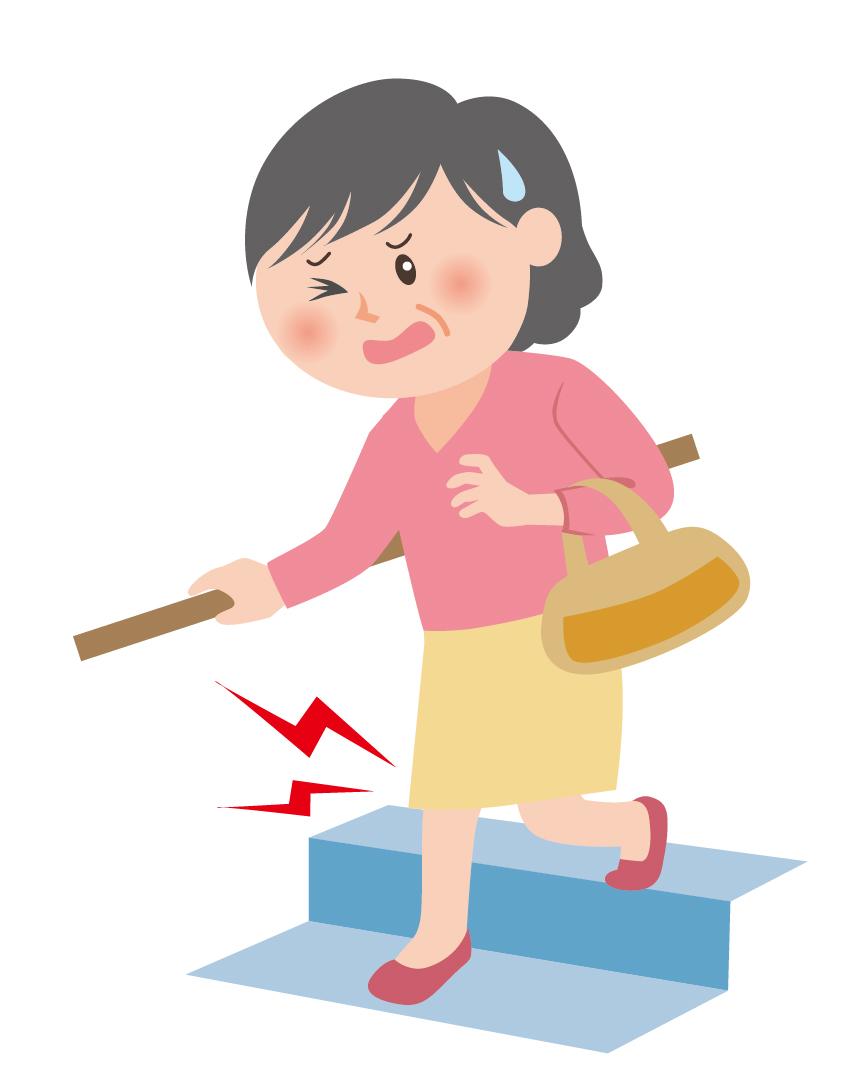 階段を降りて膝が痛む女性