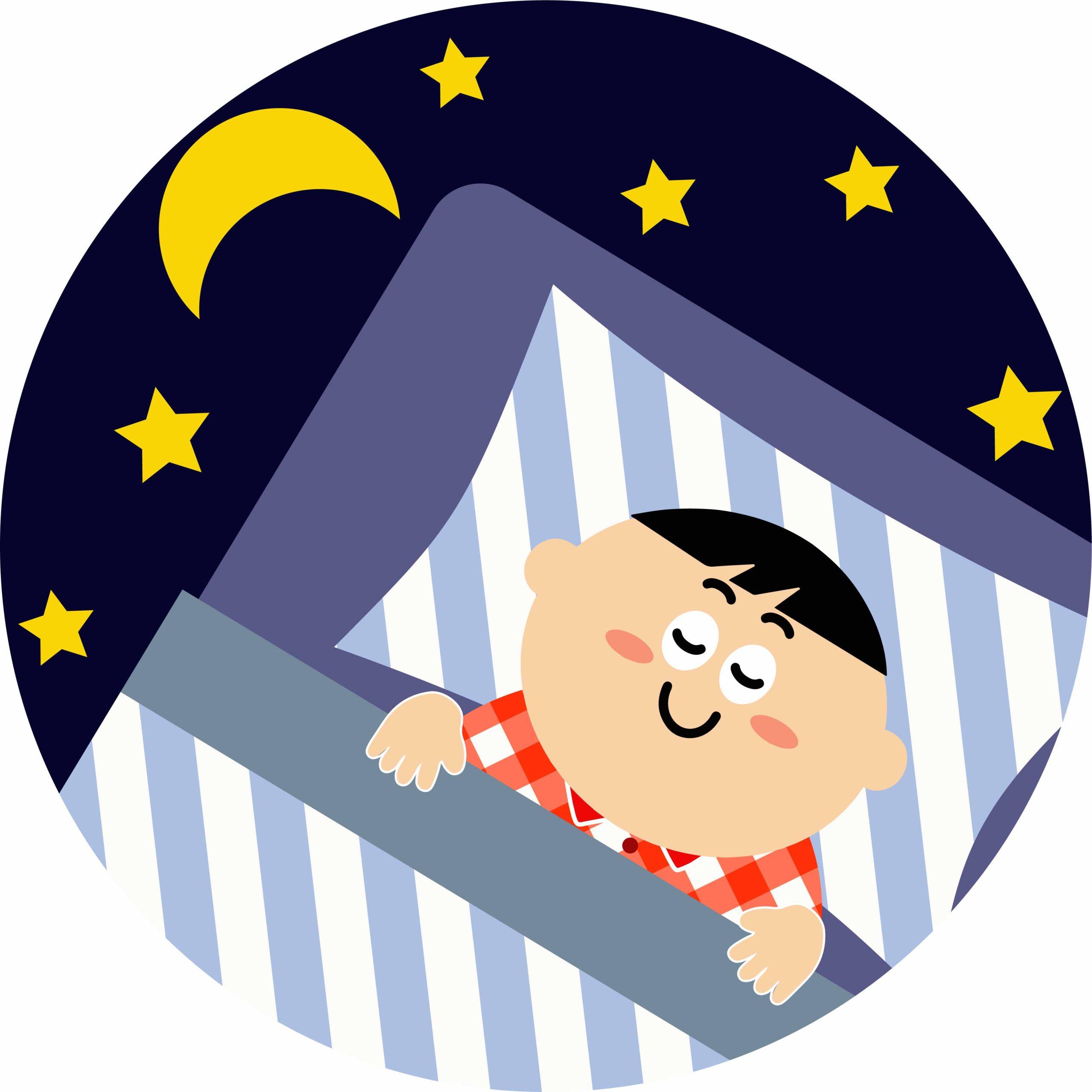夜に布団で寝る子供